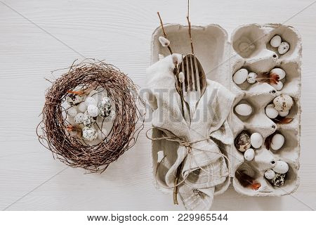 Natural Easter Table Decoration With Silverware And Eggs In A Wreath On Wooden Table