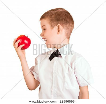 Schoolboy In Shirt With Butterfly Wants To Eat An Apple, Isolated On White Background
