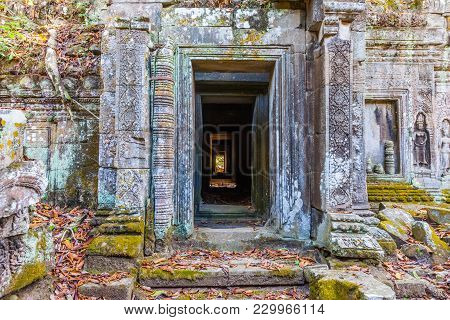 Ta Prohm, Door Corridor Through The Temple At Angkor Wat Complex In Cambodia. It Was Founded By The
