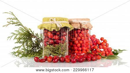 Jars Of Berries For Vitamin Tea, Next Scattered Fruit And Twig Of Thuyas Isolated On White Backgroun