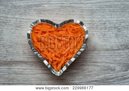 Still Life Culinary Decorations, Vegetarian, Natural And Healthy Food Grated Carrots In A Crystal Va