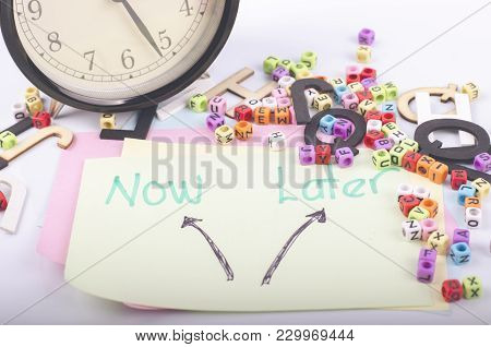Time Management And Business Concept, Choosing Now Or Later