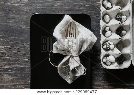 Natural Easter Table Decoration With Silverware And Egg Box On Old, Black Wooden Table