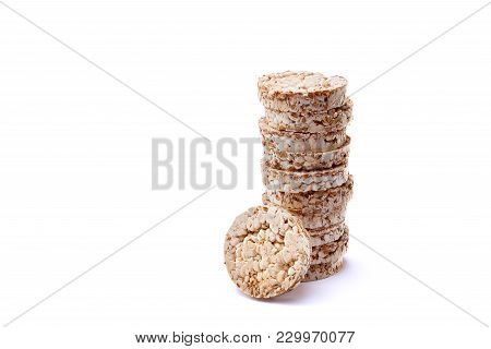 Diet Rice Cakes Pile Isolated On White Background. Composition Of Puffed Rice Snack On White Backgro