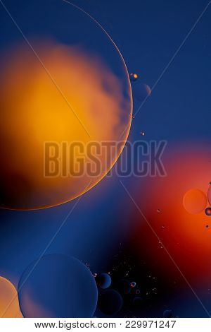 Mixing Water And Oil, Beautiful Color Abstract Background Based On Red And Yellow Circles And Ovals,