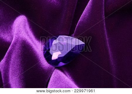 Precious stone for jewellery on purple velvet