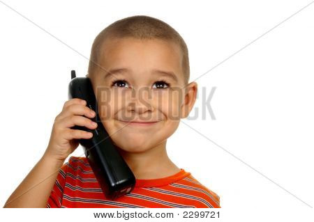 Boy Smiling On The Telephone