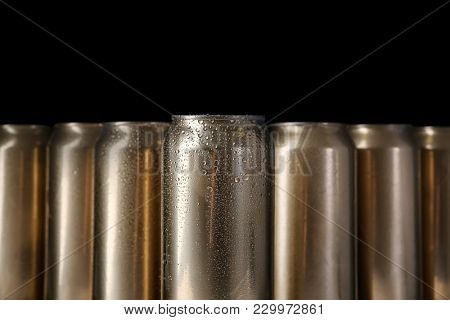 Cans of beer on black background