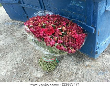 Large Bouquet Of Red Roses Thrown On The Street The Dump