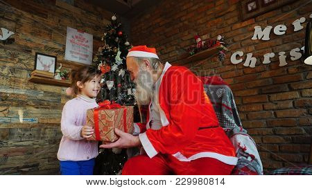 Little European Girl Whispers On Santa's Christmas Wish. ..