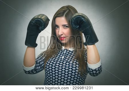 Angry Confident Woman In Boxing Gloves Are Shouting Isolated On Gray Backgroung. Wicked Dissatisfied