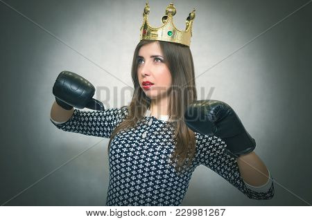 Angry Confident Woman With Gold Crown On Her Head And In A Boxing Gloves. Bossy Girl In Bad Mood Con