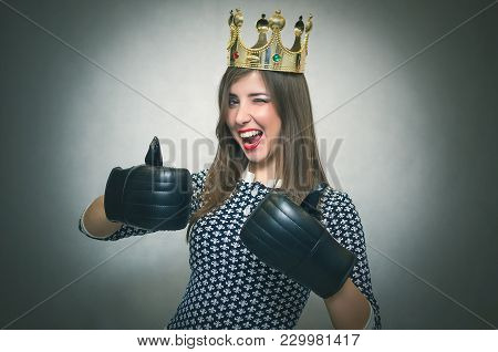 Happy Woman With Gold Crown On Her Head And In A Boxing Gloves Showing A Thumb Up. Womens Match. Wom