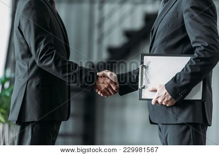 Partial View Of Senior Businessmen Shaking Hands