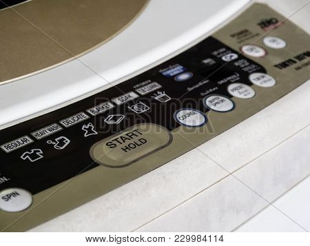 Close Up Of Control Panel At Front Of Top Loading Washing Machine