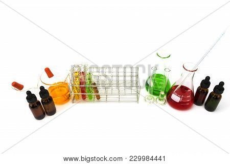 Stand With Test Tubes Isolated On White. Several Chemical Solution In Flask. Laboratory Glassware