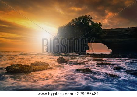 Tanah Lot Temple On Sea At Sunset In Bali Island, Indonesia.