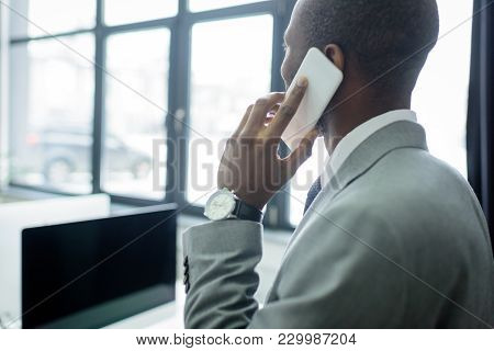 Partial View Of African American Businessman Talking On Smartphone