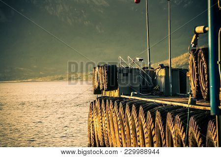 Ferry Dock With Heavy Tires And Foaming Water In Norway