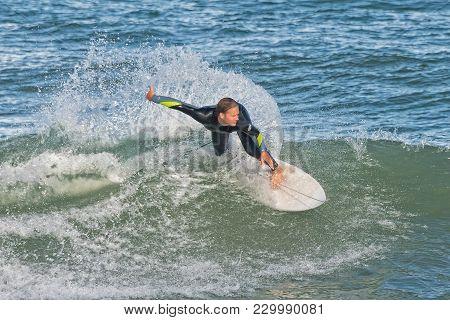 Sebastian, Florida - February 9th, 2018: Surfer Riding The Waves At Sebastian Inlet In Sebastian Flo