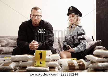 Police Staff Making Photo With Their Trophy Of Drug Find