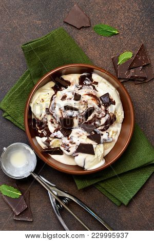 Vanilla Ice Cream With Chocolate Chips And Hot Chocolate Sauce. Summer Cold Dessert.
