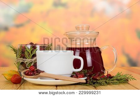 Jug With Of Broth Hips, Dried Berries In Jar And Spoon, On Wooden Table