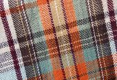 a swatch of fall - orange and brown - plaid cloth poster