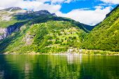 Geirangerfjord mountain view from tourist boat. Geirangerfjord located near the Geiranger village in Norway poster