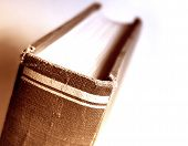 close-up of an old book (sepia tone) ** Note: Shallow depth of field poster