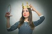 Selfish woman. Arrogant disgruntled girl with high self esteem. Egoist person woman with golden crown on her head. Dissatisfied winner. poster