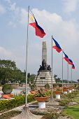 Jose Rizal monument at Luneta Park Manila with Philippine flags poster