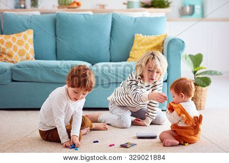 Cute Kids, Siblings Playing At Home, Elder Brother Doesn't Let The Sister To Eat Small Toy Particles