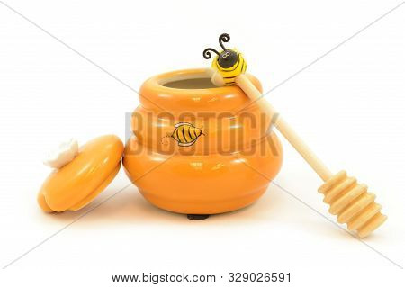 An Isolated Shot Of A Honey Pot And Drizzler.