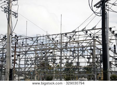 Bayamon, Puerto Rico/usa - February 15, 2019: View Of Power Grid With Poles And Wires That Provide E