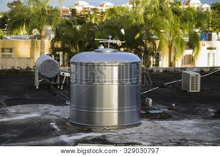 Metal Container For Water Storage On Roof Of Domestic Dwelling Bayamon Puerto Rico.