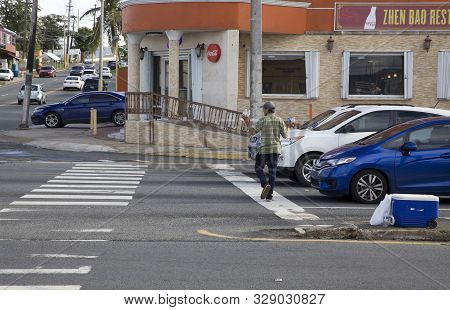 Bayamon, Puerto Rico/usa - February 11, 2019: Man Selling Bottled Water Outdoors On Local Street.