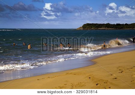 Pinones, Puerto Rico/usa - February 10, 2019: Beach Swimmers Enjoy The Beach Water On The Northeast