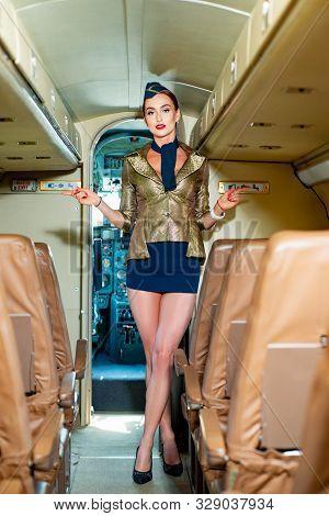 Plane Travel. Charming Stewardess. Portrait Of Charming Stewardess Wearing In Blue Uniform. Aviation