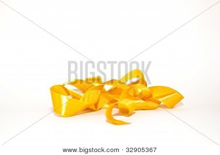 Curly gold ribbon hanging isolated on white
