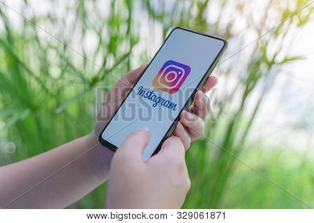 Chiang Mai, Thailand - Oct.18,2019: Woman Holding Xiaomi Mi Mix 3 With Logo Of Instagram Application