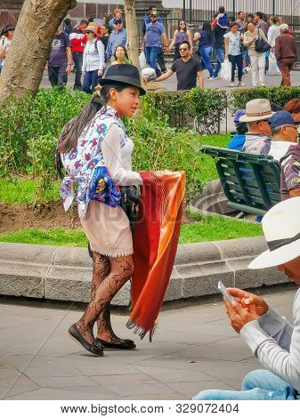 Quito, Ecuador, September 29, 2019: Indigenous Person In The Historic Centre Of Quito, Ecuador. Proc