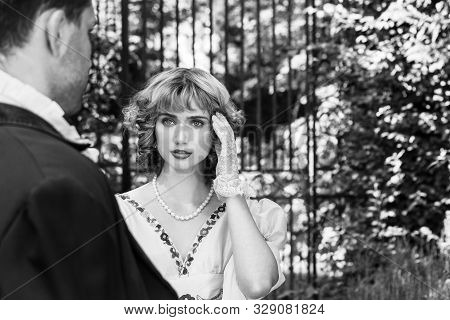 Beautiful Lady In Regency Clothing Standing In Garden Looking Longingly At Her Gentleman With Should