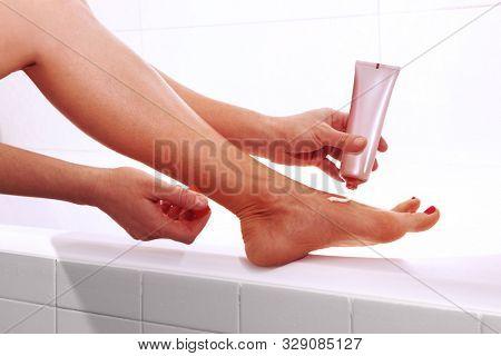 Leg of woman. Applying foot cream. Healthy treatment.