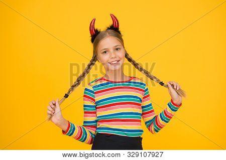 Easy Holiday Hairdo For Long Length Hair. Halloween Child Hold Long Plait Hairdo. Small Girl Wear Re
