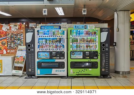 TOKYO, JAPAN - SEPTEMBER 8, 2018: Vending machines with wide variety of soft drinks and tea. Beverage vending machines ore very common across whole Japan