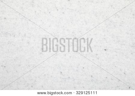 Grey non-woven fleecy synthetic polyester fabric sheet textured background