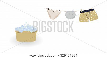 Concept Of Washing And Drying: Washed Cute Family Underwear. Man Boxers, Woman Knickers And Child Pa