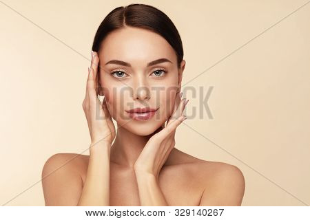 Skin Care, Beauty Anti Aging Treatment And Spa Concept. Attractive Model With Brown Hair And Clean F