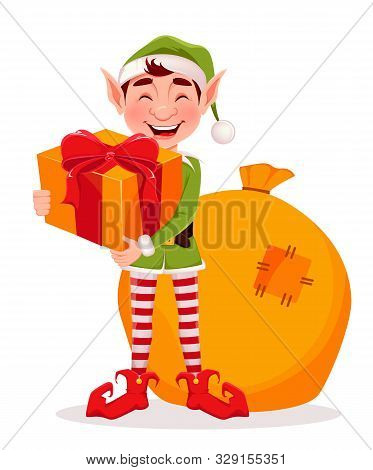 Merry Christmas Greeting Card With Funny Elf. Santa Claus Helper Elf Holding Gift Box. Cartoon Chara